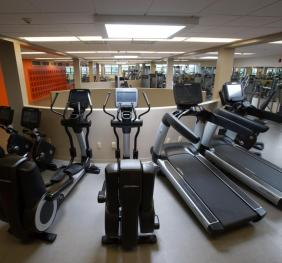 fitness center view with treadmills