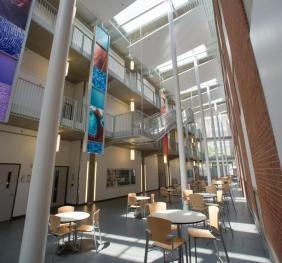 3 story atrium showing skylights, seating and graphic panels